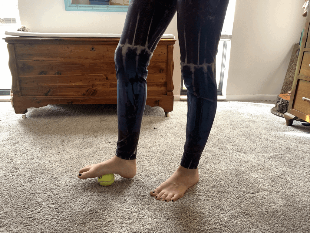 tennis ball rolling for foot relief